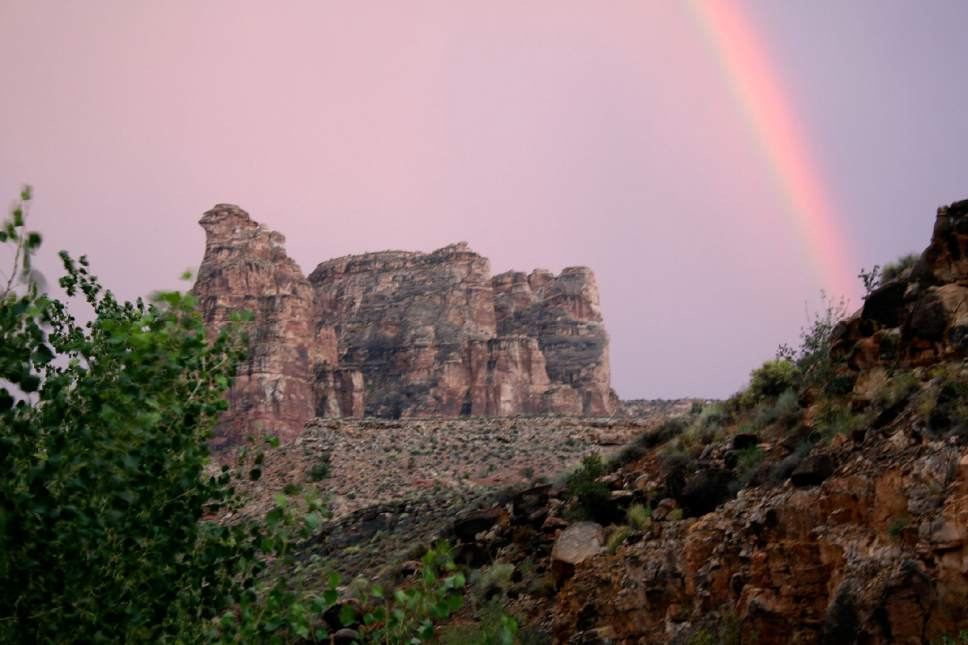 (Al Hartmann | Tribune file photo) Rainbow forms at the end of the day in Dark Canyon Wilderness in San Juan County. The area is included for a proposed Bears Ears National Conservation Area.